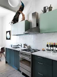 Contemporary Kitchen With Stainless Steel Hood And Two Toned Painted