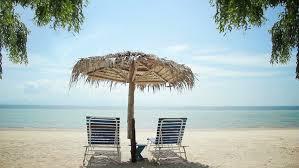 beach umbrella and chair. Wonderful Beach Beach Chair Umbrella Stock Video Footage  4K And HD Clips   Shutterstock Intended Umbrella And Chair
