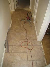 How To Tile A Kitchen Floor Tiles Laying Kitchen Floor Tiles Laying Kitchen Floor First Tile