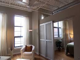 The hip-looking sliding door segregates the space for this Adams Morgan loft  condo