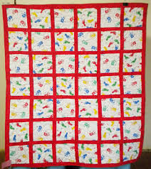 Custom Baby Quilts - Onesie Quilts by MyTyme Creations & Handmade custom Handprints quilt for baby or child. Adamdwight.com