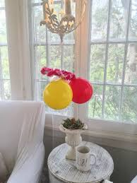once you are done with this now hang the balloon all around the ring place them in a manner that the balloons are evenly placed and you are done