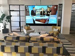 traditional office design. A Full-wall Display By SiliconCore And Chunky, Patterned Sofa Act As \u201c Traditional Office Design (