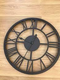 metal skeleton roman numeral wall clock
