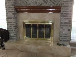 image of installing tile over brick fireplace