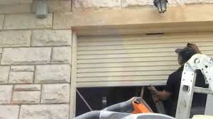 How To how to paint a door with a roller images : Paint a garage roller door - YouTube