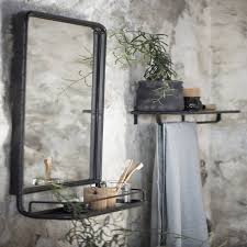 large industrial wall mirror with mini shelf storage organising