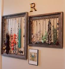 Old picture frames with hooks to hang necklaces, bracelets and on the sides  more hooks