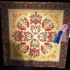The quilt contains blocks from the book