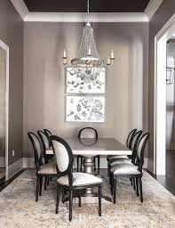 gray dining room with gray dining table and gold and gray rug