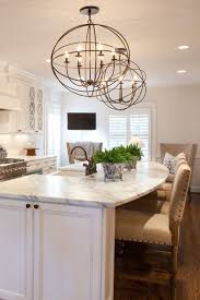 stunning kitchen with white cabinets farmhouse sink large island with seating and granite countertops