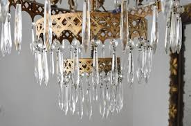 this is a precious italian chandelier from italy it features eight arms and flanked with