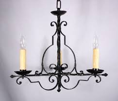 this is a wonderful antique wrought iron three light french chandelier dating from the 1930 s the chandelier begins with a simple iron bowl atop a twisted