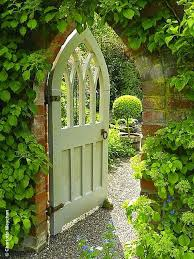 beautiful painted gothic wooden gate and wollerton old hall gardens source the galloping gardener photography by charlotte weychan
