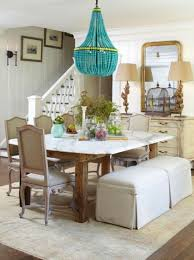 turquoise beaded chandelier and marble top dining table