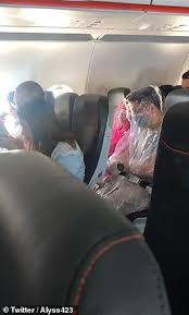 worried air passengers wrap themselves