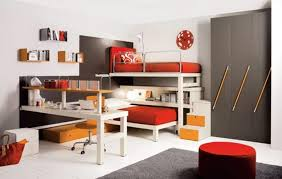 awesome kids bedroom with two red beds grey cabinet white desk and yellow stoolwhite wooden floor and gery velvet rug image