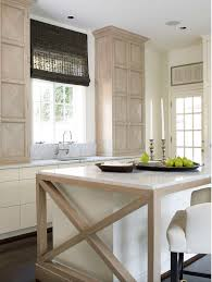 pale neutral kitchens - Cream, light wood and white kitchen with a  Hollywood Regency cabinet