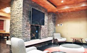 norstone charcoal rock panels used on a common room fireplace on john st in new york