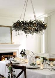 a hanging wreath chandelier with silver ornaments and lights