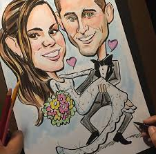 mark gootz adds finishing touches to a custom wedding gift caricature from photos um is black ink watercolor and prismacolor art stix