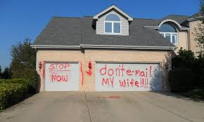 don t e mail my wife scorned husband spray paints furious message on man s garage door