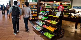 nutritional science majors walk by a health food on cus nutritional science degree
