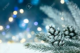 Christmas Tree Cone With Lights Silver Christmas Tree Branch With Pine Cones On Blurred Blue