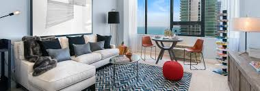 white sofa and patterned rug in living room of 1 bedroom apartment for rent  in the
