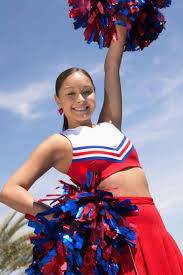 portrait of a age cheerleader holding pompoms