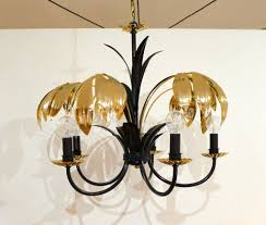 five armed chandelier with black and gold metal and palm leaves 1970s