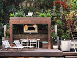 small fireplace beneath pergola