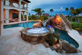 backyard pools with waterfalls and slide. Perfect Waterfalls A Stone Stairway Leads To The Top Of This Water Slide Set Above A Lit And Backyard Pools With Waterfalls Slide