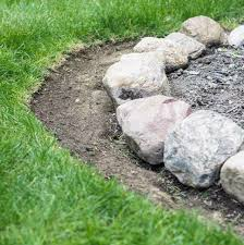 easy step by step that shows how to maintain a garden rock border