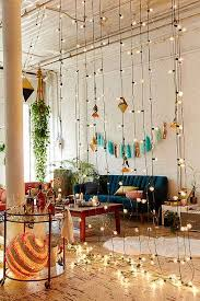 Bohemian lighting Flush Mount First Step Acquire Globe String Lights Then Throw In Rattan Chair Colorful Throw Pillows Few Motivational Posters Of Vanessa Hudgens At Coachella Hometown Evolution Patio Globe String Lights Bohemian Lighting Hometown Evolution