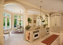 mediterranean kitchen with flat panel cabinets by jordan hoffsmith