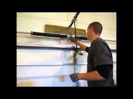 how to install garage door torsion