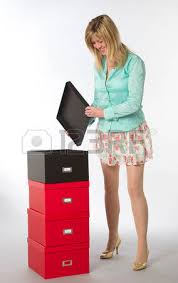 file boxes female office worker checking and stacking file boxes boxes stack office file