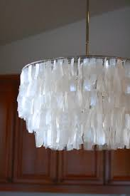 amazing capiz chandelier for your home lighting design natural white round capiz chandelier for modern