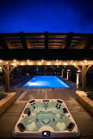 in ground hot tub and pool combination at night tranquility kits uk