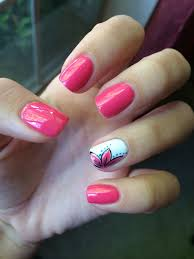 Nail Art Different Designs On Each Finger Pink Nails With A White Ring Finger That Has A Flower Design