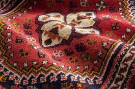 close up of the central part of a persian shiraz oriental carpet