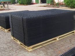 black welded wire fence. Two Pallets Of Black PVC Coated Welded Wire Panels On The Ground Fence