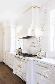 alyssa rosenheck white and gold kitchen with silestone marble like countertops