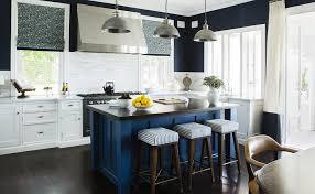 blue kitchen island with dark woof countertop