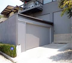 converting a carport into a garage is no easy task it s all in the details when building custom wood garage doors and tungsten royce clearly captured every