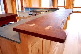 this live edge walnut top feautres ernut erfly joints and tops custom ernut cabinetry for a