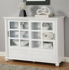 furniture white wooden bookcase with double sliding glass and white wooden door on laminate flooring