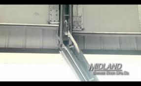 midland garage doorsMidland Garage Door Swing Up Center Post System  YouTube