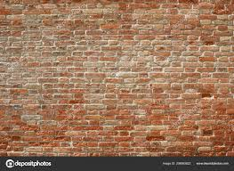 old red brick wall texture background sunlight shadows stock photo